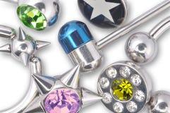 许多刺穿的珠宝 免版税库存图片