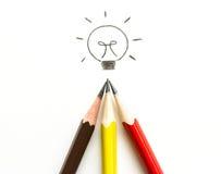 许多在白色的铅笔图电灯泡 库存照片