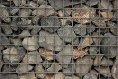许多在笼子的石头 免版税库存图片