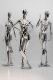 许多塑造衣裳的发光的母时装模特 金属manne 图库摄影