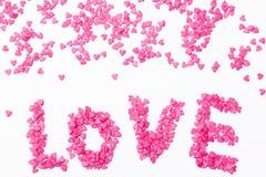 许多小心脏`爱`在白色背景的 库存照片