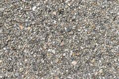 许多小的石头构造背景 小灰色石头纹理有用为拷贝空间、背景或者艺术品 免版税图库摄影