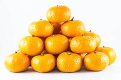 许多新鲜的未加工的桔子 免版税图库摄影