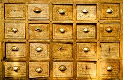 许多木出票人配件箱 免版税库存图片