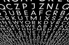 许多白色sans字母表信件 免版税库存照片