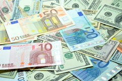许多美元和欧元 免版税库存图片
