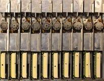 许多老减速火箭的磁盘驱动器从便携式计算机 步进moto 免版税库存照片