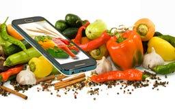 许多菜和一个手机特写镜头的图象 库存照片