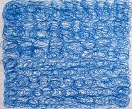 许多蓝色花体画与圆珠笔 库存照片