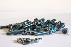 许多银色公尺机器螺丝 免版税库存照片