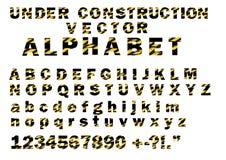 建设中条纹图形样式传染媒介在字母表字体上写字 库存图片
