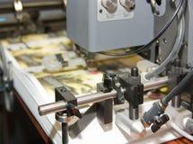 设备被打印的报纸抵销 库存图片