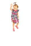 设法的小女孩跳跃 免版税库存照片