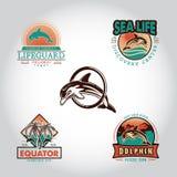 设置与用手被画的海豚的葡萄酒徽章 库存照片