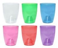 设置兰花植物的五颜六色的透明塑料罐 免版税图库摄影