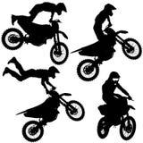 设置剪影在摩托车的摩托车越野赛车手 免版税库存图片