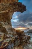 设置在拉古纳海滩的太阳 库存照片