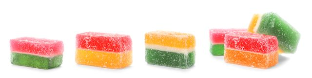 设置在白色的鲜美嚼的糖果 库存照片