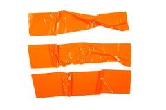 设置在白色背景的橙色磁带 库存图片