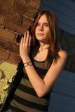 设置少年都市的女孩 图库摄影