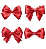 设置欢乐红色缎弓的汇集在白色的 免版税库存照片