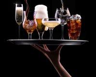 设置用在黑背景的不同的饮料 免版税库存图片
