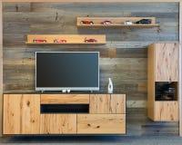 设计师有电视木碗柜的客厅墙壁 库存照片