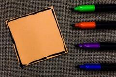 设计广告网站橙色纸重要提示的企业概念空的模板拷贝空间文本 库存照片