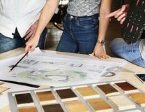 设计演播室建筑师创造性的职业会议图纸Co 免版税库存图片