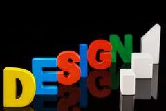 设计词的概念在五颜六色的木信件的 免版税图库摄影