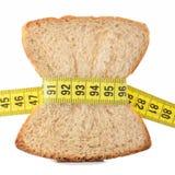 评定掌握的面包片磁带 库存照片