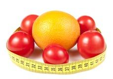 评定橙色蕃茄的范围 库存照片