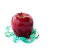 评定繁文缛节的白色的苹果背景 图库摄影