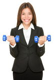 诉讼增强的哑铃重量的女商人 库存照片