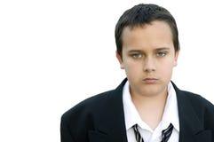 诉讼的1不快乐的男孩 免版税库存照片