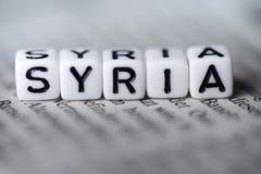 词叙利亚由在报纸的木字母表块形成了 图库摄影