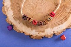 词和蔼可亲在木立方体 免版税库存图片