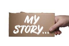 词在纸板写的我的故事 裁减路线 免版税库存照片