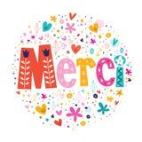 词在装饰正文卡片上写字的法国印刷术的Merci感谢 免版税库存图片