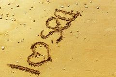 词我爱金黄沙滩的海 免版税图库摄影