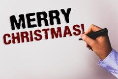 词文字文本圣诞快乐诱导电话 节日庆祝12月文本白色backgroun的企业概念 免版税库存照片