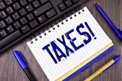 词文字文本收税诱导电话 金钱的企业概念由在笔记薄写的它的支持的一个政府要求了 库存图片