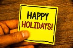 词文字文本节日快乐诱导电话 企业概念招呼的庆祝的欢乐天供以人员拿着黄色pape 库存照片
