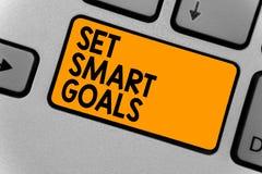 词文字文本集合聪明的目标 Establish可达成的宗旨的企业概念做好经营计划键盘橙色k 免版税图库摄影