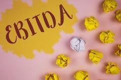 词文字文本Ebitda 收入的企业概念,在税被测量评估在Painted前写的公司表现 免版税库存图片