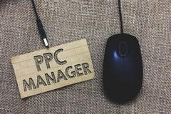 词文字文本Ppc经理 登广告者每次付费他们的广告一的企业概念是点击的纸板com 免版税图库摄影