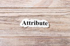 词的属性在纸的 概念 属性的词在木背景的 库存照片
