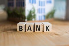 词银行的特写镜头在木块的 免版税库存照片
