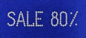 词销售在蓝色帆布bac被做假钻石水晶颜色 图库摄影