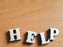 词`帮助`由木信件做成 免版税库存照片